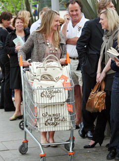 Anya Hindmarch talking to customers queuing outside a Sainsbury's store in London