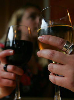 Two females drink wine in a central London pub