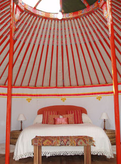 Large double bed inside a Hoopoe tent in Spain
