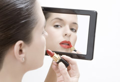 Marie Claire Issues and Campaigns: Woman putting on make-up