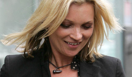 Kate Moss wearing penis shaped necklace