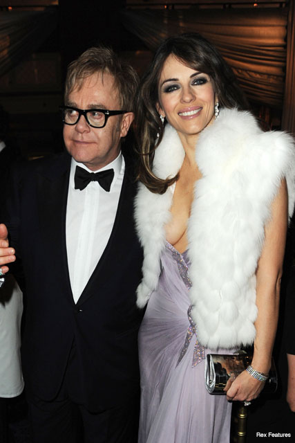 Elton John and Liz Hurley - Celebrity News - Marie Claire