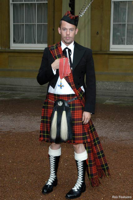 Alexander McQueen at Buckinham palace with his CBE Oct 2003