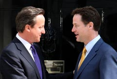 David Cameron and Nick Clegg enter Downing Street - coalition government
