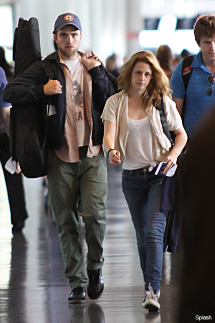 Robert Pattinson & Kristen Stewart stop hiding romance - Rob, Kristen, R-Patz, K-Stew, spotted, together, airport, LAX, Montreal, kissing, Twilight, see, pics, pictures, best moments, couple, public, relationship, Marie Claire