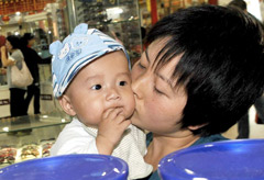 Marie Claire World News: Woman with baby - China milk scandal