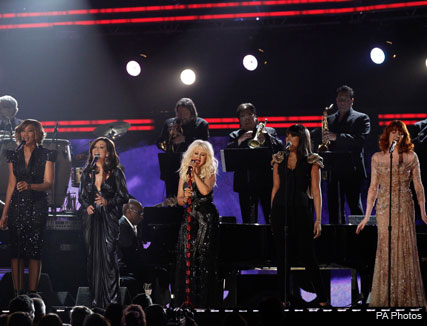 Christina Aguilera - Christina Aguilera takes a tumble during Grammys performance - Grammys 2011 - Christina Aguilera Grammys performance - Celebrity News - Marie Claire - Marie Claire UK