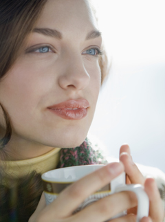 Woman drinking coffee - Marie Claire news