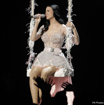 Katy Perry - WATCH! Katy Perry shows off wedding snaps during Grammys performance - Grammys 2011 - Katy Perry Grammys - Katy Perry Wedding - Katy Perry Russell Brand - Russell Brand Katy Perry Wedding - Wedding Pictures - Katy Perry Grammy Awards - Perfor