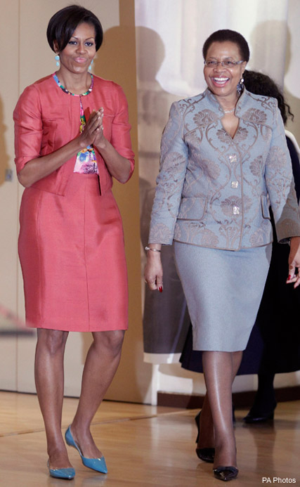 Michelle Obama walks with Nelson Mandela
