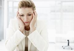 Woman at work, woman worried, woman streesed at work, woman stressed, upset woman
