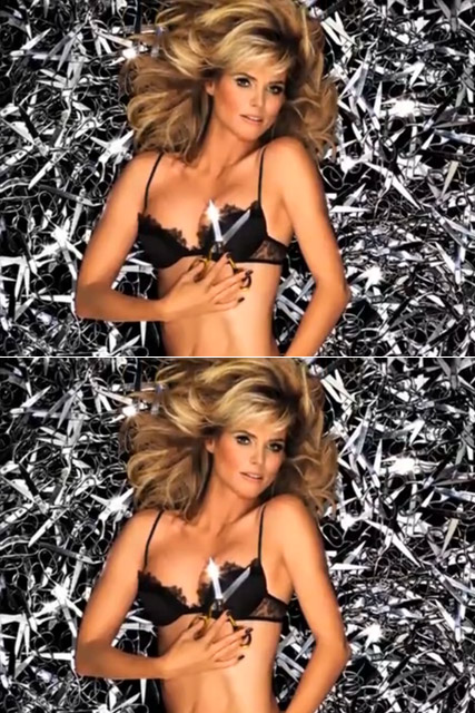 Heidi Klum poses on a bed of scissors for new Project Runway ad