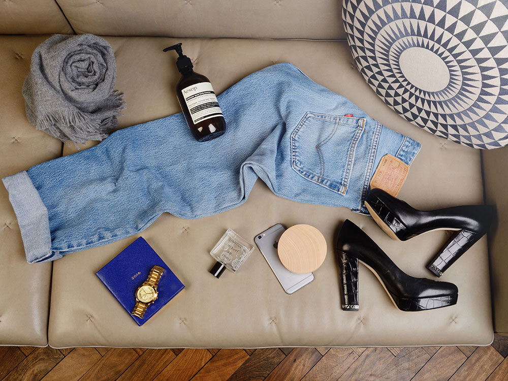 A travel bag, including Michael Kors heels and Levis