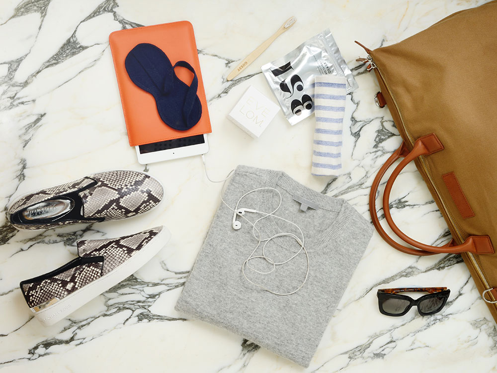 A travel bag - including snakeskin trainers and cashmere jumper