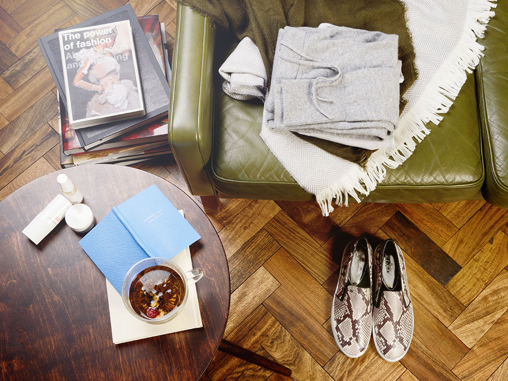 Michael Kors slip on trainers and a cashmere blanket