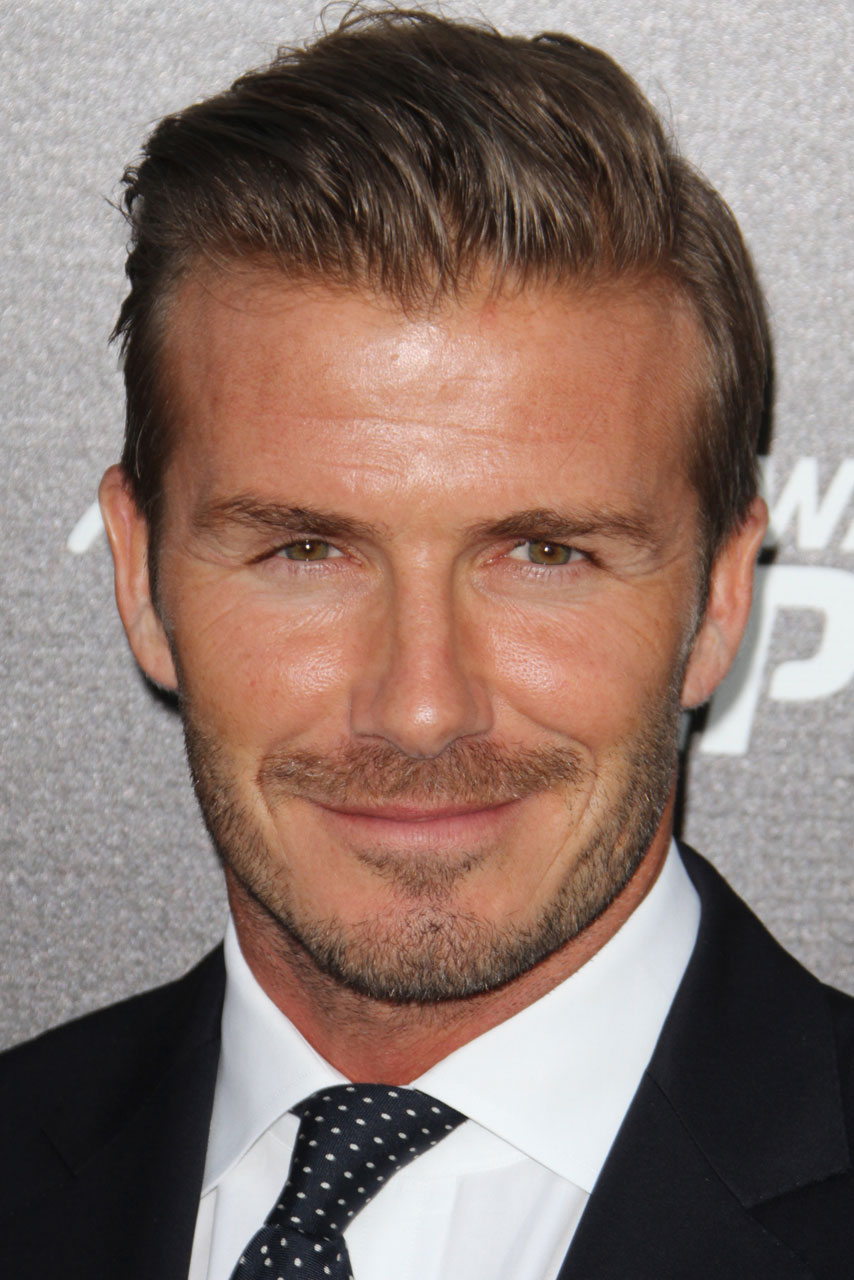 David beckham is all smiles as he attends sports event without wife victoria beckham for David beckham