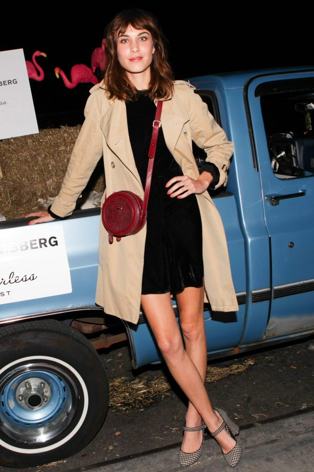 Alexa Chung in a velvet dress and trench coat