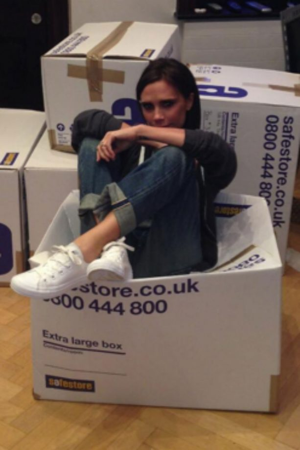 Victoria Beckham gets stuck in while packing clothes for charity