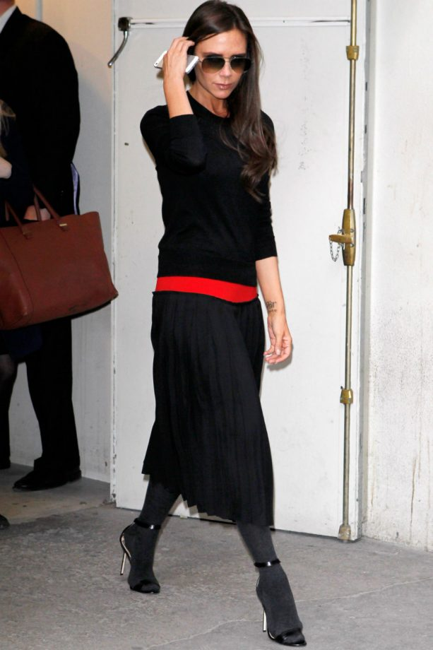 Victoria Beckham wears tights and sandals