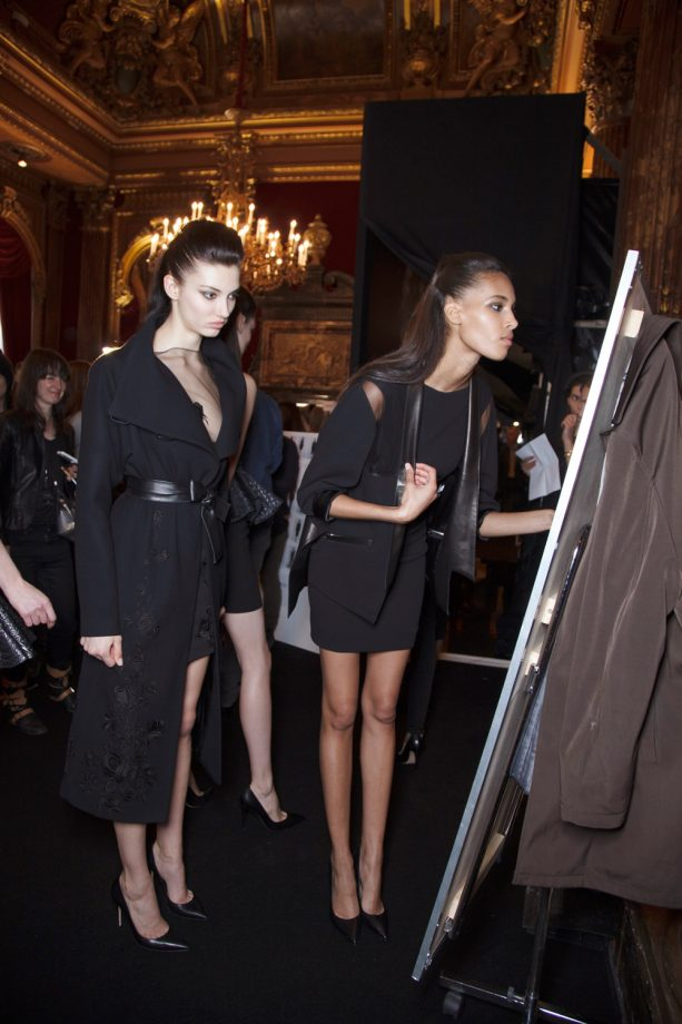 Photo of models looking in The Skinny Mirror