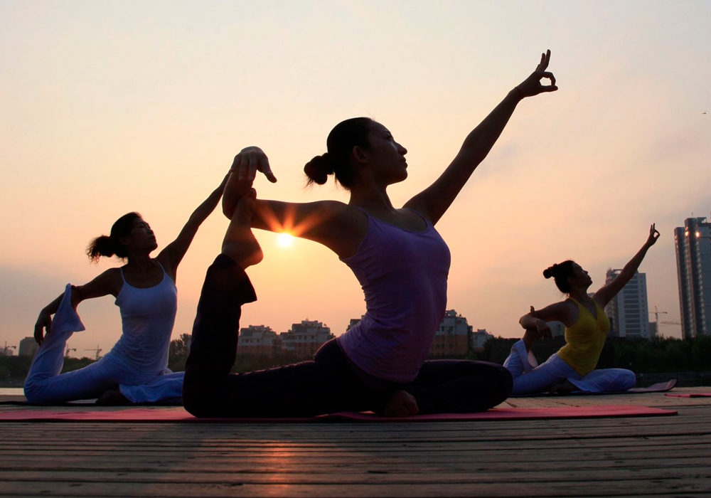 Yoga classes six new types of yoga to try right now solutioingenieria Images