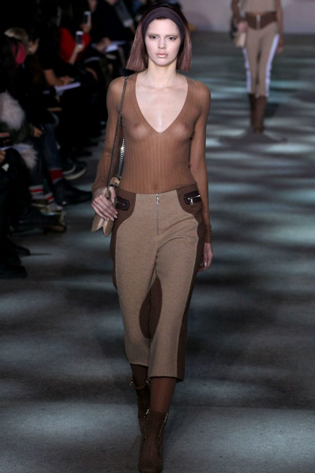 Kendall Jenner models for Marc Jacobs in a sheer top.