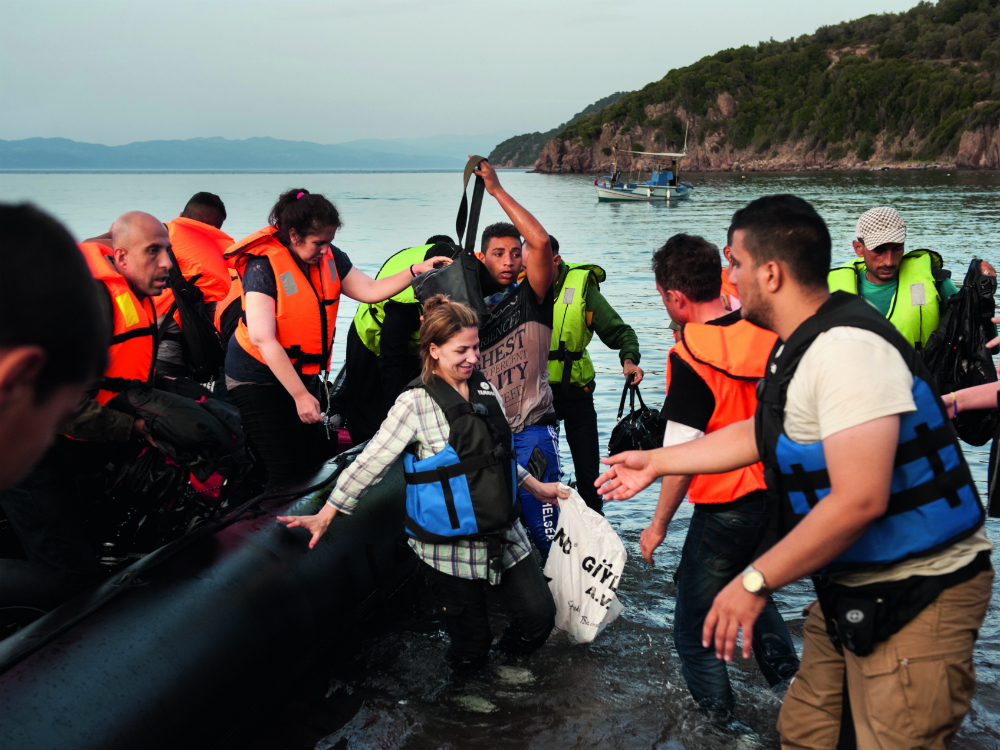 Refugees getting off boats