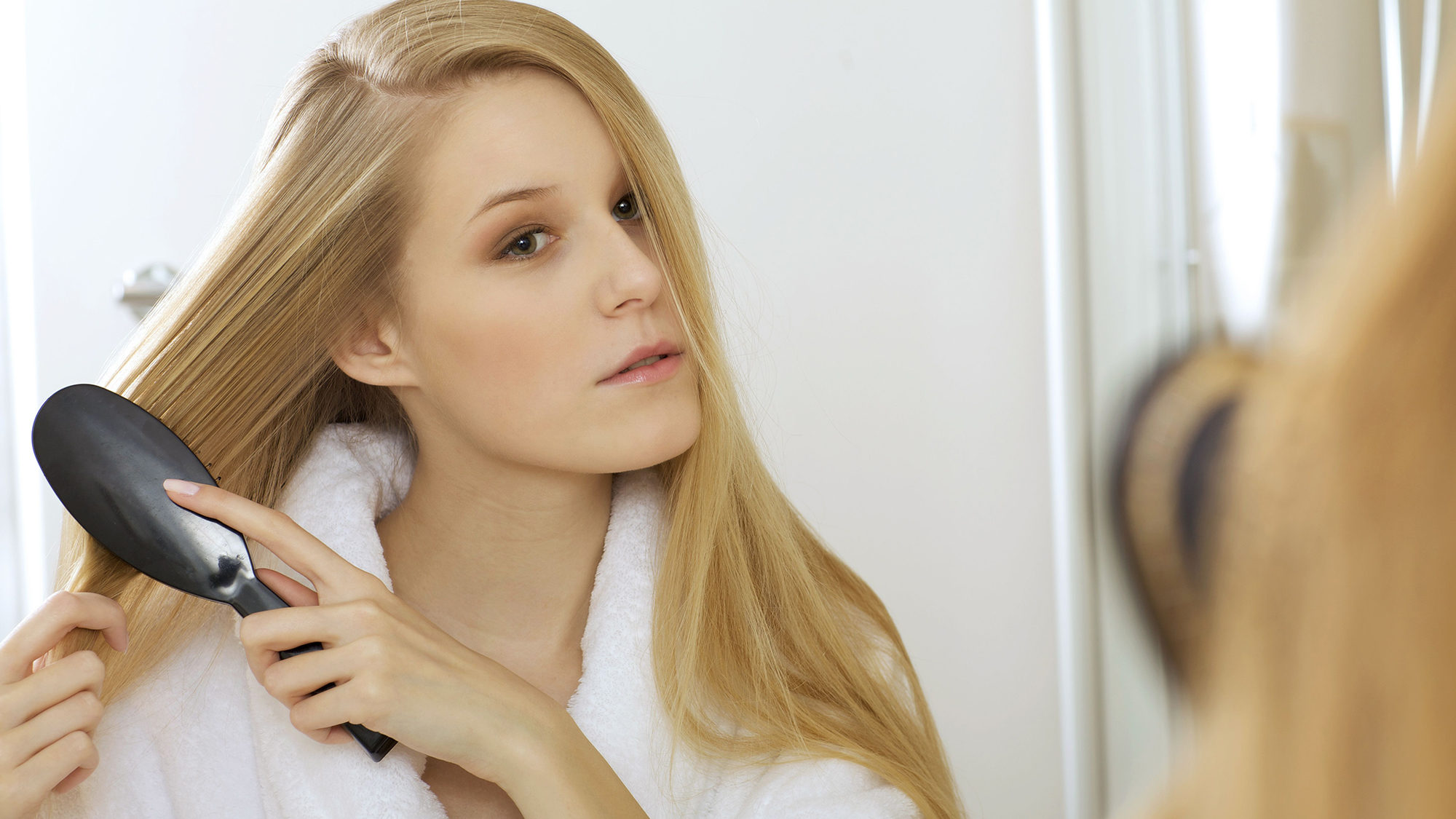 The way you're brushing your hair could be ruining it