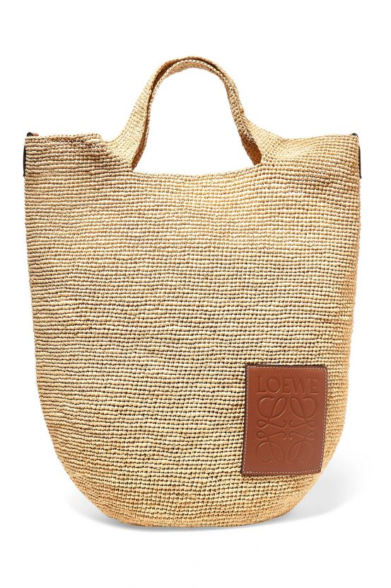 7f7e08dfa6 Designer beach bags. Shop now  LOEWE Slit leather-trimmed woven raffia tote  for £550 from Net-A-Porter