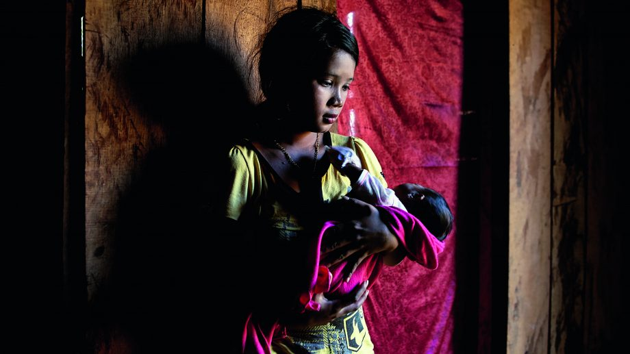 Teenage mother and baby in Cambodia