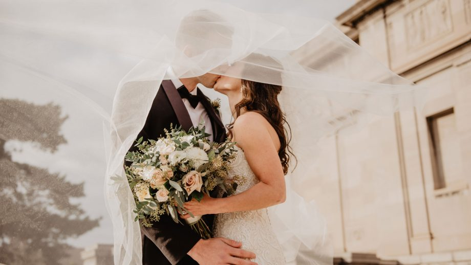 Wedding readings: a couple kisses on their wedding day