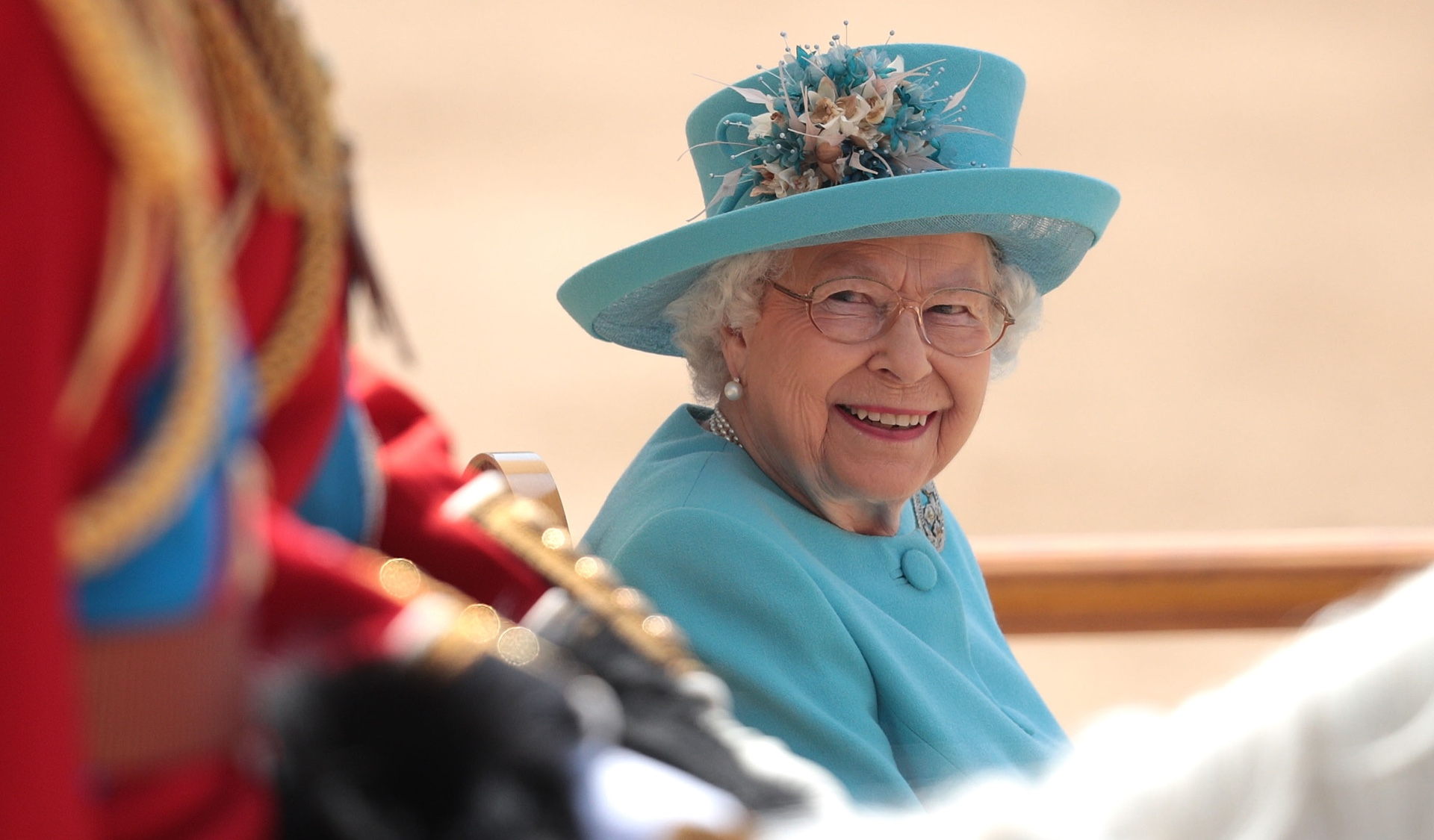 The Queen may have just thrown some shade at Prince Harry and Meghan Markle