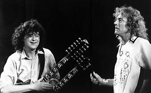 """Former """"Led Zeppelin"""" band members Jimmy Page, left, and Robert Plant perform at the Atlantic Records 40th anniversary celebration at New York's Madison Square Garden, May. 15, 1988. (AP Photo/Mario Suriani)"""