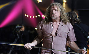 British hard rock singer Robert Plant performs on the main stage, during the Paleo open air music Festival in Nyon, Switzerland, Thursday, July 26, 2007. Plant is the singer with Led Zeppelin. (AP Photo/Keystone, Martial Trezzini)
