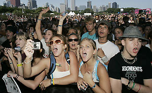 Excited fans watch as the Las Vegas-based band Panic! At the Dicso performs at Lollapalooza 2006 Friday, Aug. 4, 2006, in Chicago. (AP Photo/Charles Rex Arbogast)
