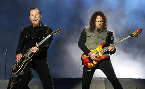 James Hetfield (left) and Kirk Hammett of Metallica perform on day three of the Reading Festival 2008, Berkshire.