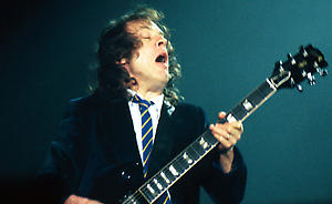 Angus Young of AC DC performing live in concert at Newcastle Arena.