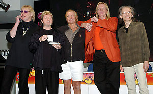 70s rock band Yes (left-right) Chris Squire, Jon Anderson, Alan White, Rick Wakeman and Steve Howe during a in-store signing for their new DVD 'Yes Acoustic', at HMV Oxford Street, central London.