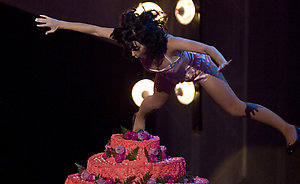 Pop-rock singer Katy Perry jumps on a giant cake while performing during the 2008 MTV Latin Video Music Awards at the Telmex Auditorium in Guadalajara, Mexico, Thursday Oct. 16, 2008. (AP Photo/Alexandre Meneghini)