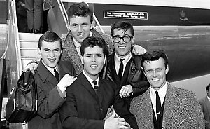 Pop singer Cliff Richard and members of his supporting instrumental band The Shadows at London Airport as they are about to fly off on their Scandinavian Tour.