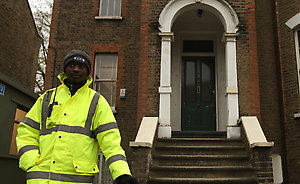 A security guard stands outside 94 Dalston Lane, Hackney, London, which contains the workshop of drum maker Fernando Gomez, who died after exposure to anthrax.