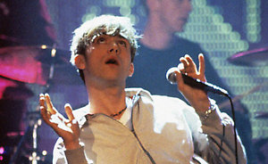 Blur frontman Damon Albarn in action on stage