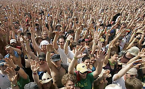 ** FILE ** The crowd cheers a concert by Damian Marley at the Bonnaroo Music & Arts Festival in Manchester, Tenn., in this June 17, 2006, file photo. The Bonnaroo festival draws 80,000 people to a farm in rural Manchester, and not all of them want to sweat through four days of music under questionable weather and crammed into crowded tents. Summer music festivals attract and accommodate such fans by offering special VIP packages, promising a hassle-free weekend for an extra price. (AP Photo/Mark Humphrey)