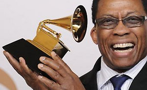 Herbie Hancock is seen with the award for best contemporary Jazz album backstage at the 50th Annual Grammy Awards on Sunday, Feb. 10, 2008, in Los Angeles. (AP Photo/Mark J. Terrill)