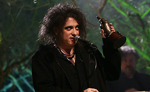 Robert Smith of The Cure receiving The Godlike Geniuses award on stage during the Shockwaves NME Awards 2009 at the 02 Academy, Brixton, London
