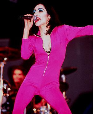 PJ Harvey performs live at Glastonbury 1995.3/4 length, pink jumpsuit, catsuit.