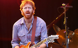 ** FILE ** Trey Anastasio, looks over the crowd as Phish plays the song Runway Jim, during their first set at the Phish Festival in Coventry, Vt., in this Aug. 14, 2004, file photo. (AP Photo/Alden Pellett, file)
