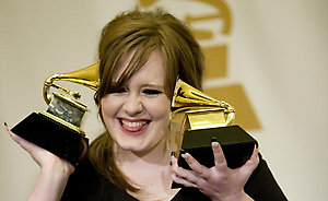 Adele holds her grammy awards for best new artist and best female pop vocal performance backstage at the 51st annual Grammy Awards in Los Angeles.