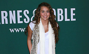 "Miley Cyrus at a signing of her new book, ""Miles to Go"".
