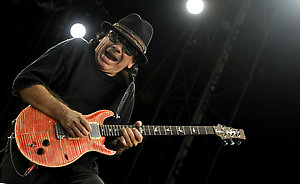 Mexican rock musician Carlos Santana, performs during a concert in Budapest, Hungary, Saturday, April 28, 2008. (AP Photo/Bela Szandelszky)